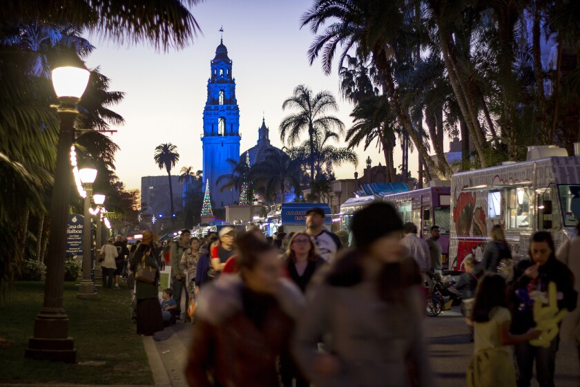 Food trucks line El Prado walkway at Balboa Park.