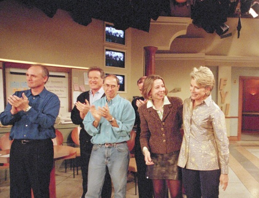 """Diane English, the executive producer hugging Candice Bergen, right, at the filming of the last episode of """"Murphy Brown"""" in 1998."""