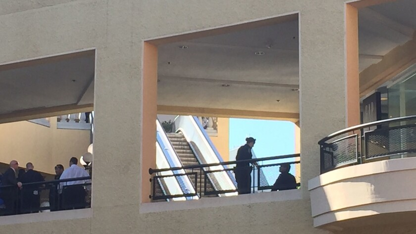 Officers investigating after a woman shot herself in front of the Gap at Horton Plaza.