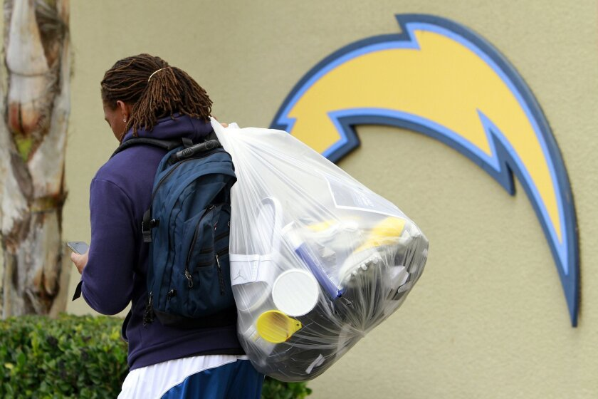 Wide receiver Legedu Naanee heads out of Chargers Park the day after a disappointing 2010 season came to a close.