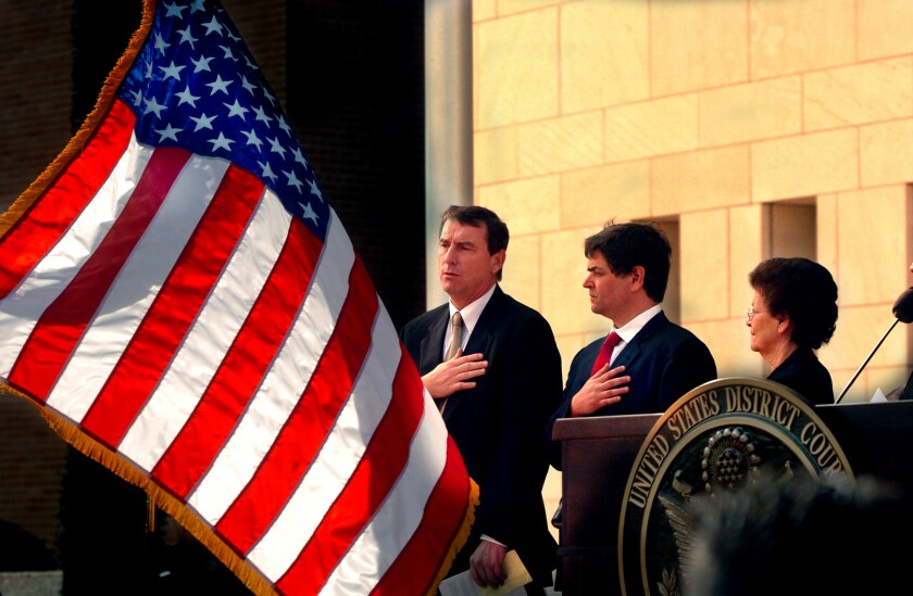 U.S. District Judge Andrew S. Hanen, shown at left in 2005, temporarily blocked President Obama's executive actions on immigration, giving 26 states time to pursue a lawsuit that aims to permanently stop the orders.