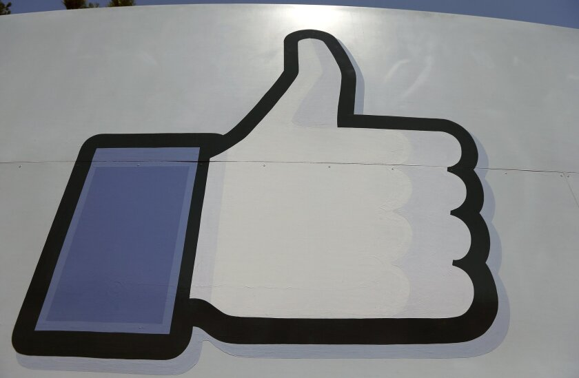 """Facebook's """"like"""" symbol at the entrance to the company's Menlo Park campus."""
