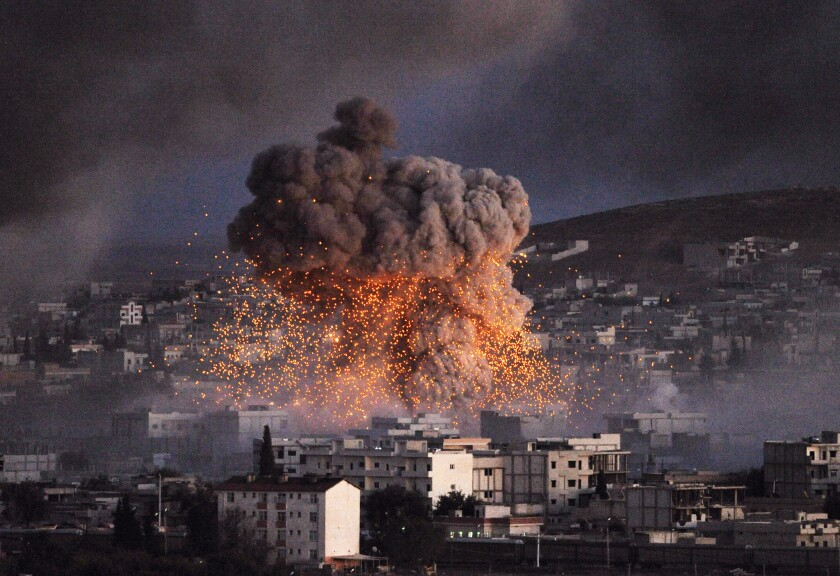 A suicide car bomb attack, reportedly by Islamic State militants, rocks a neighborhood in the Syrian city of Kobani.