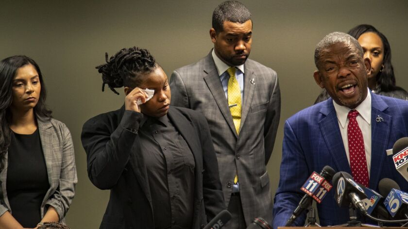 Psykyssyanna Hart, the twin sister of Jonathan Hart, wipes away tears as family attorney Carl Douglas announces the family's plan to file a $525-million wrongful-death lawsuit against Walgreens. Jonathan Hart was killed by an armed security guard at a Walgreens in Hollywood.