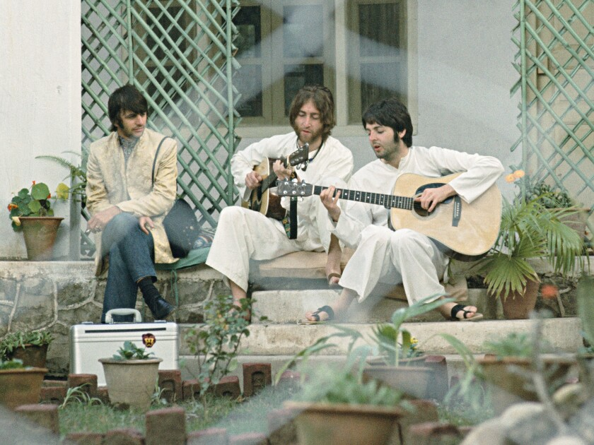 "Ringo Starr, John Lennon and Paul McCartney at an ashram in 1968 in the documentary ""Meeting the Beatles in India."""