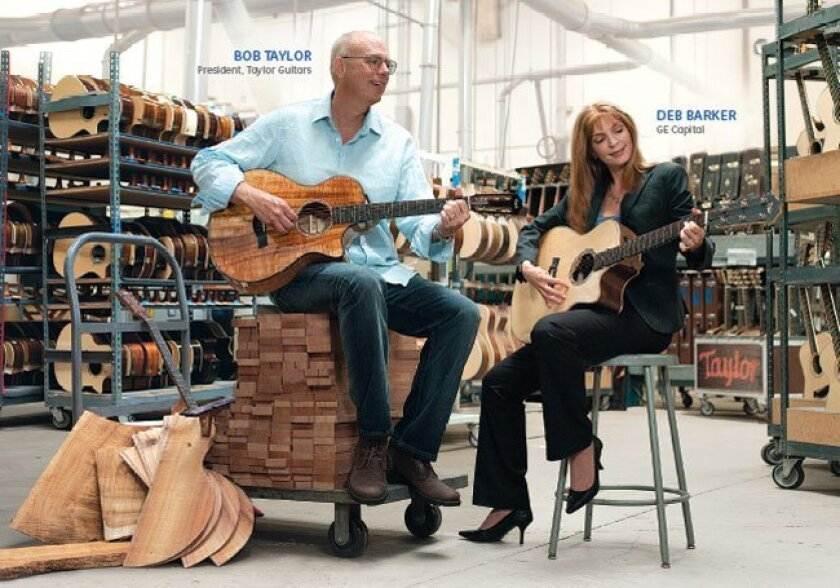 This image from a GE Capital ad shows Bob Taylor, president of Taylor Guitars and Deb Barker, GE Capital Relationship Executive.