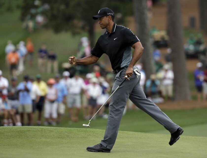 Tiger Woods pumps his fist after a birdie on the seventh hole during the second round of the Masters golf tournament Friday, April 10, 2015, in Augusta, Ga. (AP Photo/Matt Slocum)