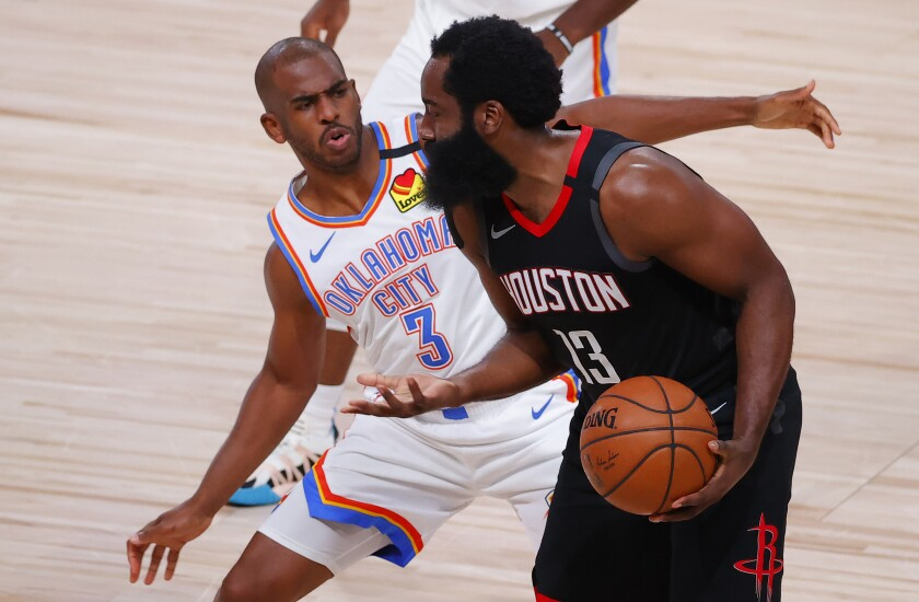 Thunder guard Chris Paul plays tight defense on former teammate and Rockets star James Harden.