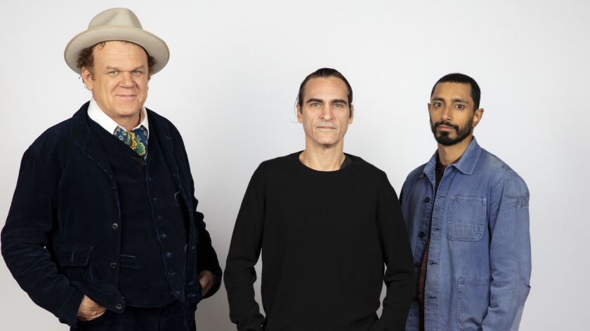 TORONTO, ONT., CA -- SEPTEMBER 09, 2018-- Actor/Producer John C. Riley, actor Joaquin Phoenix, and a