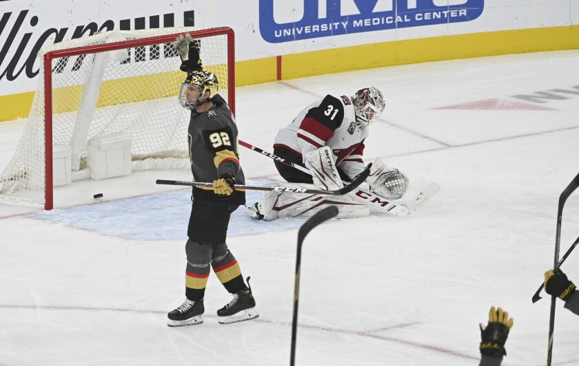 Vegas Golden Knights left wing Tomas Nosek (92) reacts after scoring against Arizona Coyotes goaltender Adin Hill (31) during the third period of an NHL hockey game Sunday, April 11, 2021, in Las Vegas. (AP Photo/David Becker)