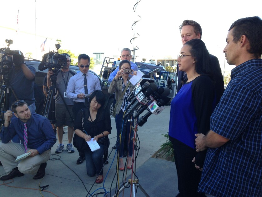 Jamie, her fiance, right; and her attorney address the media in front of Alhambra High School on Tuesday afternoon.