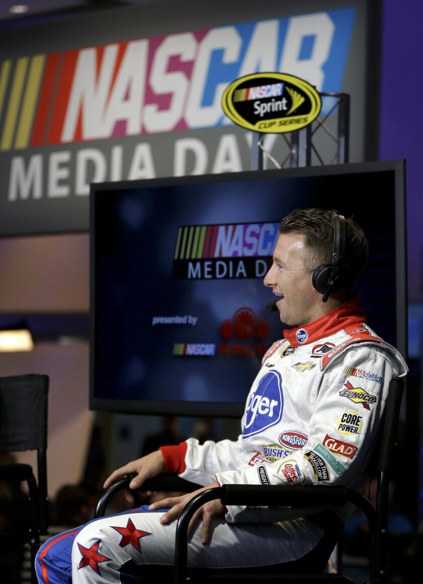 AJ Allmendinger takes part in an interview during NASCAR media day at Daytona International Speedway, Tuesday, Feb. 16, 2016, in Daytona Beach, Fla. (AP Photo/John Raoux)