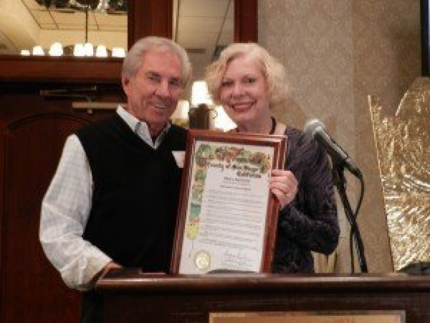 Jim Watkins and Supervisor Pam Slater-Price, who presented Watkins with a proclamation.