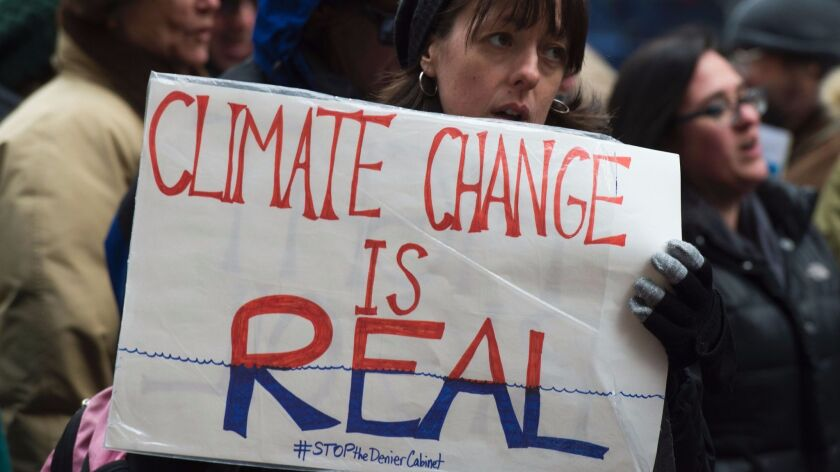 Activists in New York rally to urge politicians to stand against climate change denial.