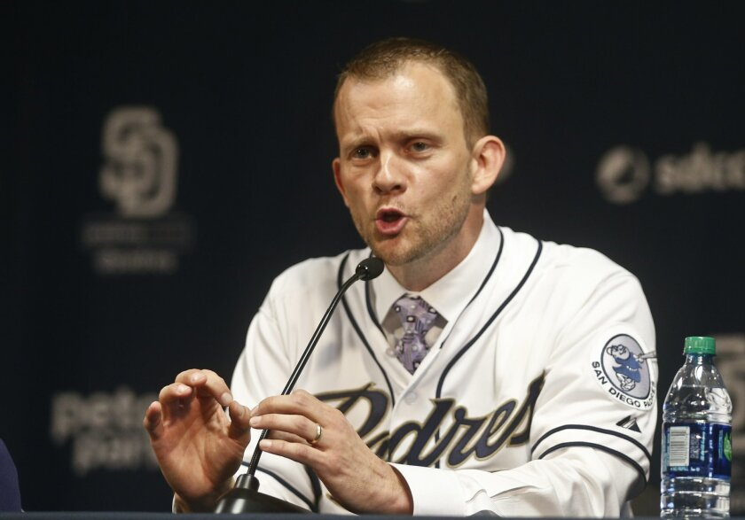 Andy Green, the new manager of the San Diego Padres, speaks at a news conference announcing his hiring Thursday, Oct. 29, 2015, San Diego. (AP Photo/Lenny Ignelzi)