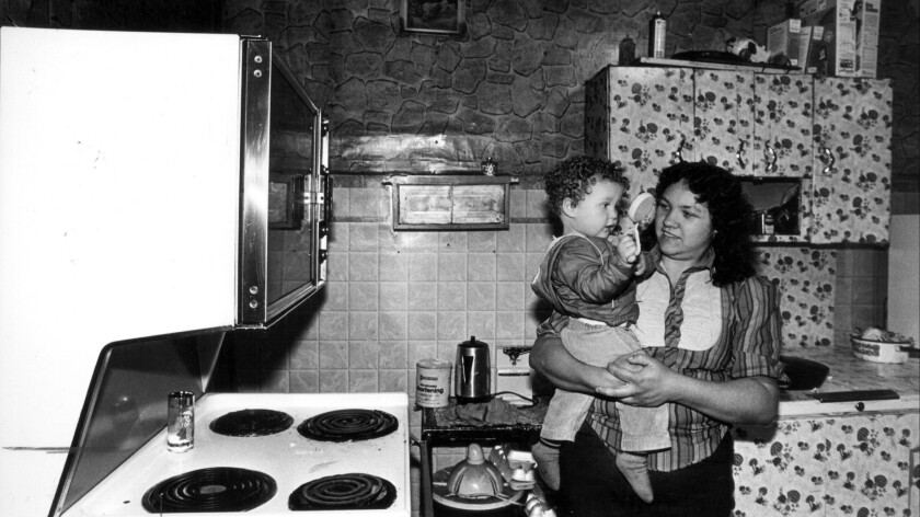 At the home of Roger Luster in Welch, W. Va, Roger and wife Dodie with their children. Dobie prepares spaghetti dinner. Roger watches TV.