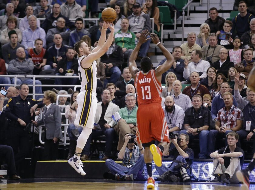 Utah Jazz forward Gordon Hayward shoots as Houston Rockets guard James Harden (13) defends during the first quarter of an NBA basketball game Tuesday, Feb. 23, 2016, in Salt Lake City. (AP Photo/Rick Bowmer)