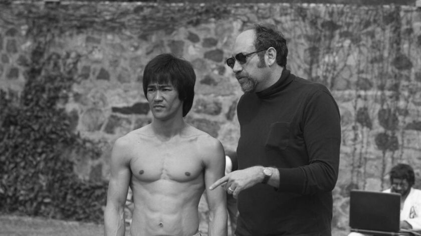 "Bruce Lee, left, with ""Enter the Dragon"" producer Fred Weintraub. The producer, who also owned the folk and comedy club the Bitter End, died on Sunday."