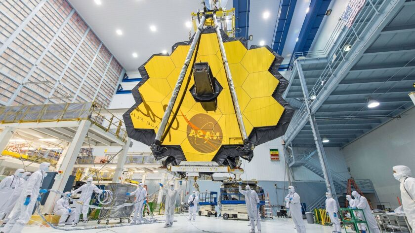 NASA technicians lift the primary mirror of the James Webb Space Telescope at the Goddard Space Flight Center in Greenbelt, Md., in April 2017.