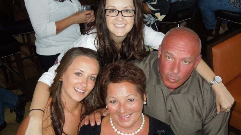 Nancy Bauerlein, her two step-daughters, Stephanie Macia and Katie Muren, and her husband, Pete Baue