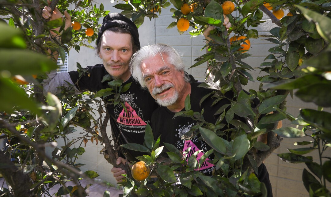 """William Gary Graves, left, who has had AIDS for years, and his partner and caregiver, Michael """"Mikie"""" Lochner, right, at their North Park home, February 13, 2020 in San Diego, California."""