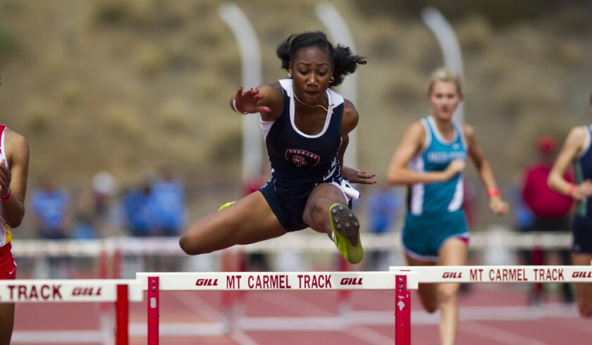 Steele Canyon senior Tajanique Bell wins the 300-meter hurdles in an outstanding time of 41.99 seconds.