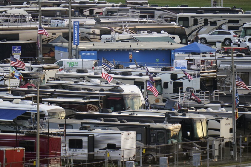 Motor homes are shown in the infield at the Daytona International Speedway before a truck race Friday, Feb. 12, 2021, in Daytona Beach, Fla. Daytona is used to shirtless fans partying in the infield. But what about maskless ones? Usually the biggest NASCAR party of the season, the sport will have to figure out how to police up to 30,000 fans who may have little interest in sticking to the pandemic guidelines. How many fans will actually come remains to be seen? (AP Photo/Chris O'Meara)