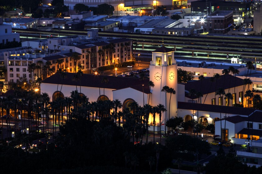 Union Station is illuminated at night in tribute and memory of L.A. Times Food critic Jonathan Gold on Saturday, July 28, 2018 in Los Angeles, Calif. (Patrick T. Fallon/ For The Los Angeles Times)