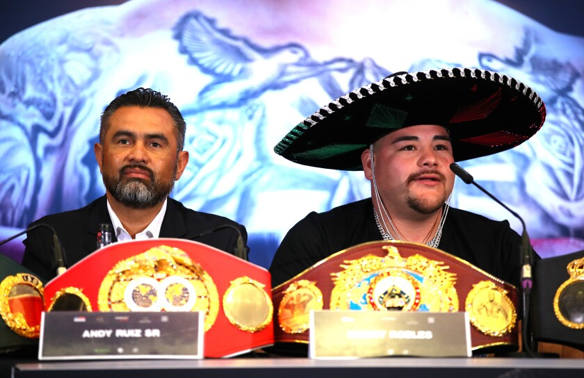 Andy Ruiz Jr. and Manny Robles address reporters during a news conference Sept. 6 in London.