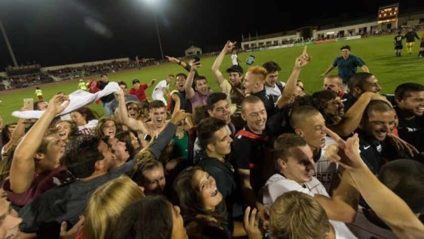 Fans rush the Sports Deck field after SDSU upset No. 1-ranked Akron in men's soccer.