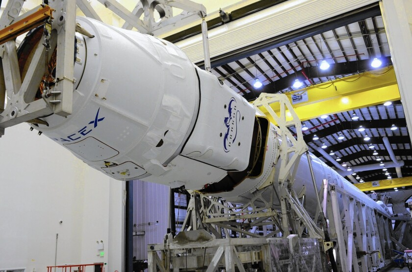 A SpaceX Dragon capsule, which has been used to deliver supplies to the International Space Station for NASA, is mated to a Falcon 9 rocket also made by SpaceX.