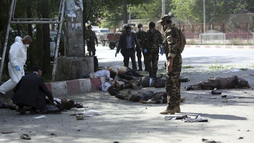 A coordinated double suicide bombing hit central Kabul, leaving victims sprawled on the ground in the Afghan capital on April 30, 2018.