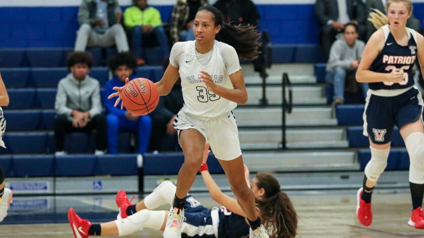 Sierra Canyon's Alexis Mark leads a break after stealing the ball from Viewpoint in the second half of the Trailblazers' 71-49 victory on Wednesday