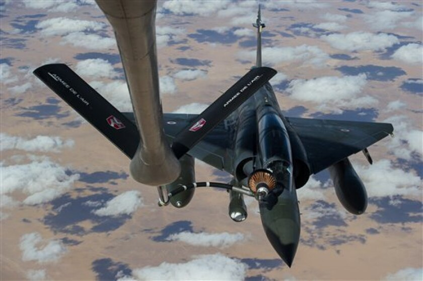 This picture released by the French Army Communications Audiovisual office (ECPAD) shows a French Mirage 2000 D aircraft refueling while flying to N'Djamena overnight January 11 to 12, after taking off from the French military base of Nancy. The battle to retake Mali's north from the al-Qaida-linked groups controlling it began in earnest Saturday, after hundreds of French forces deployed to the country and began aerial bombardments to drive back the Islamic extremists from a town seized earlier this week. (AP Photo/ R.Nicolas-Nelson, Ecpad)
