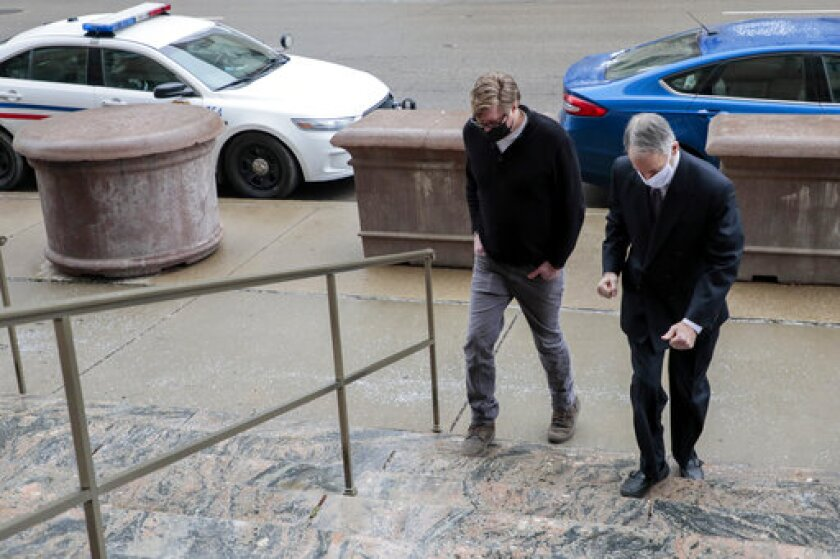 Two men arrive at a courthouse.