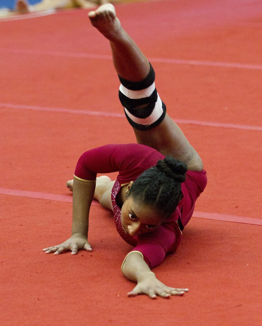 Mt. Carmel's Ruby Harrison, who won the optional all-around, performs her floor exercise routine at the Mt. Carmel Invitational.