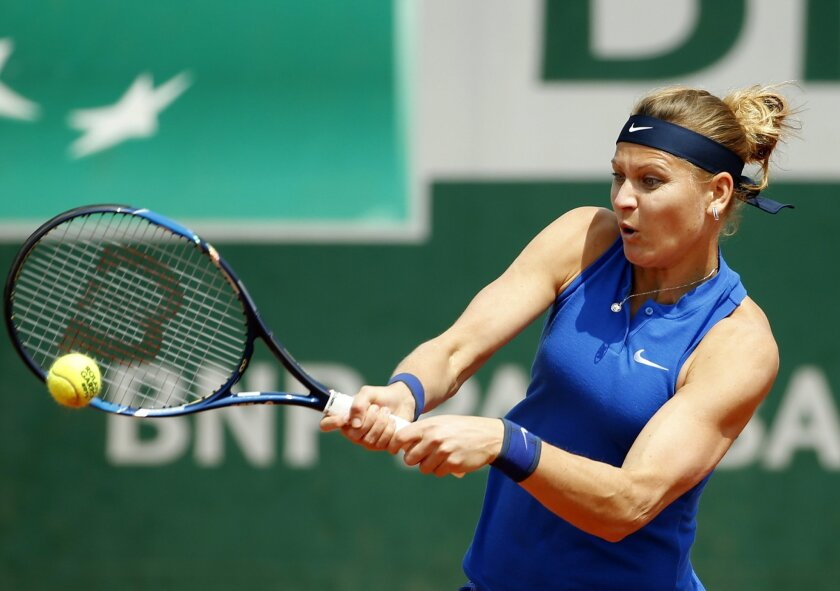 Lucie Safarova of the Czech Republic returns the ball to Switzerland's Viktorija Golubic  during their second round match of the French Open tennis tournament at the Roland Garros stadium, Wednesday, May 25, 2016 in Paris.  (AP Photo/Alastair Grant)