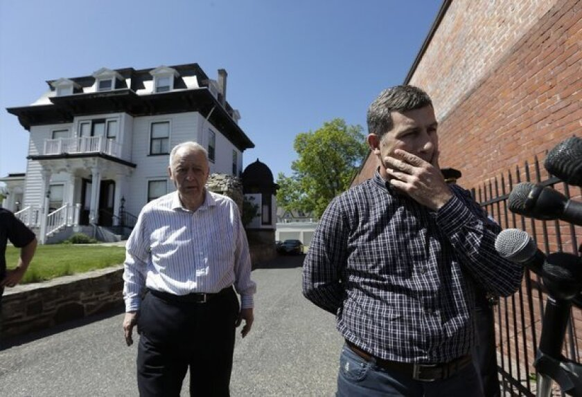 Ruslan Tsarni, uncle of slain Boston bombing suspect Tamerlan Tsarnaev, told reporters his nephew should be buried in Cambridge. City officials have said they would reject a burial permit application. At left is Peter Stefan of the Graham, Putnam & Mahoney Funeral Parlors in Worcestor, Mass.