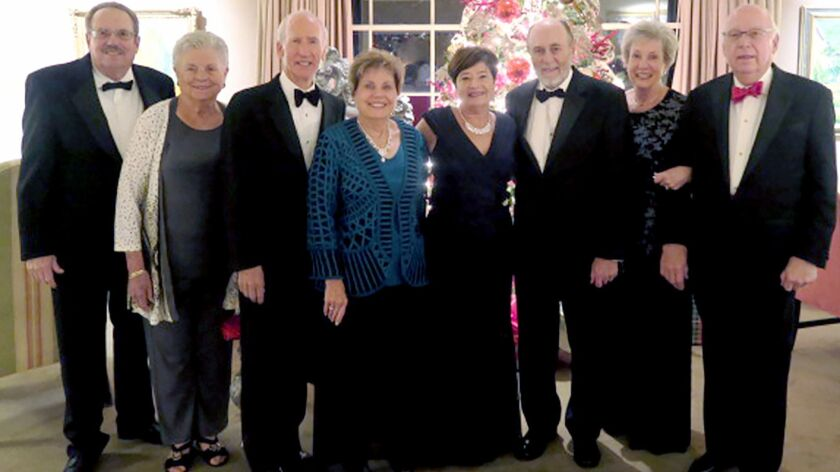 Taking part in the holiday dinner dance for Stardusters Alaroma are, from left, Jim Nigra, Sue Franz