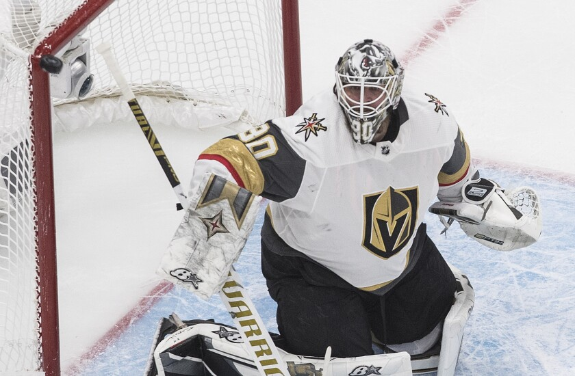 The puck hits the post as Vegas Golden Knights goaltender Robin Lehner watches during the first period of Game 3 of the team's NHL hockey Western Conference final against the Dallas Stars, Thursday, Sept. 10, 2020, in Edmonton, Alberta. (Jason Franson/The Canadian Press via AP)