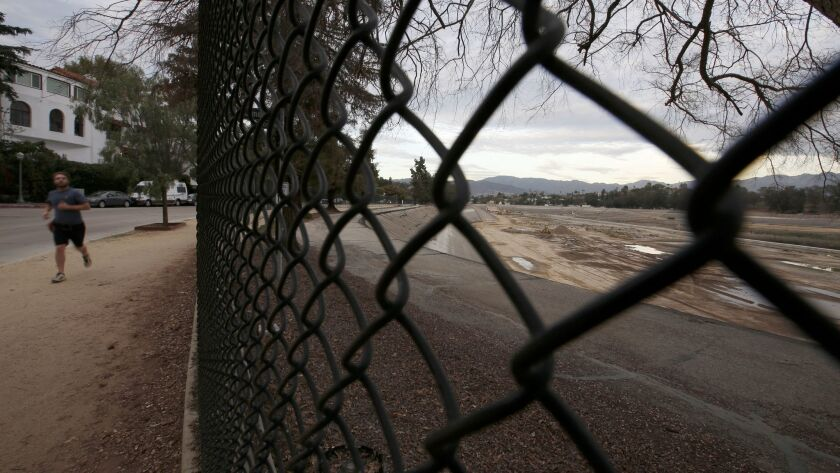 The empty Silver Lake Reservoir, drained as part of a DWP project to bring a new underground reservoir online, has been an eyesore for a year.