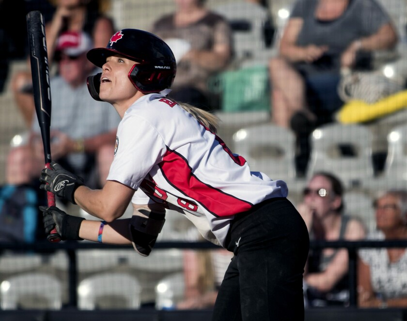 FILE - In this Aug. 27, 2019, file photo, Canada's Victoria Hayward watches her inside-the-park grand slam against Guatemala during the first inning of a game in the Softball Americas Olympic qualifier tournament in Surrey, British Columbia. Hayward would have been in Japan right about now preparing for the Olympics as captain of Canada's softball team. The coronavirus pandemic pushed the Summer Games back a year. But she will not have to wait too much longer to get back on the field. She is one of the 56 elite players signed to suit up when Athletes Unlimited launches the first of its professional women's sports leagues with a six-week season near Chicago in late August and an innovative model made for the moment. (Darryl Dyck/The Canadian Press via AP, File)