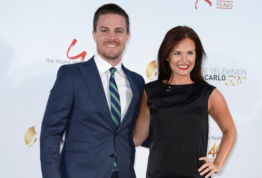 """Arrow"" star Stephen Amell and his wife Cassandra Jean are expecting a baby together, their first."