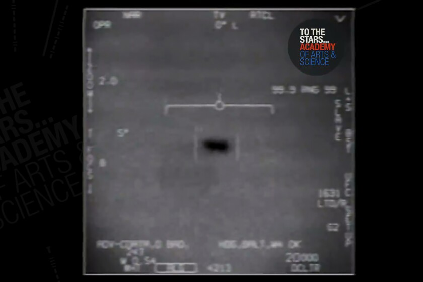 In this undated image made from video from a U.S. Navy aircraft and released by The Stars Academy of Arts & Science, an unidentified object moves near the plane in the air. (The Stars Academy of Arts & Science via AP)