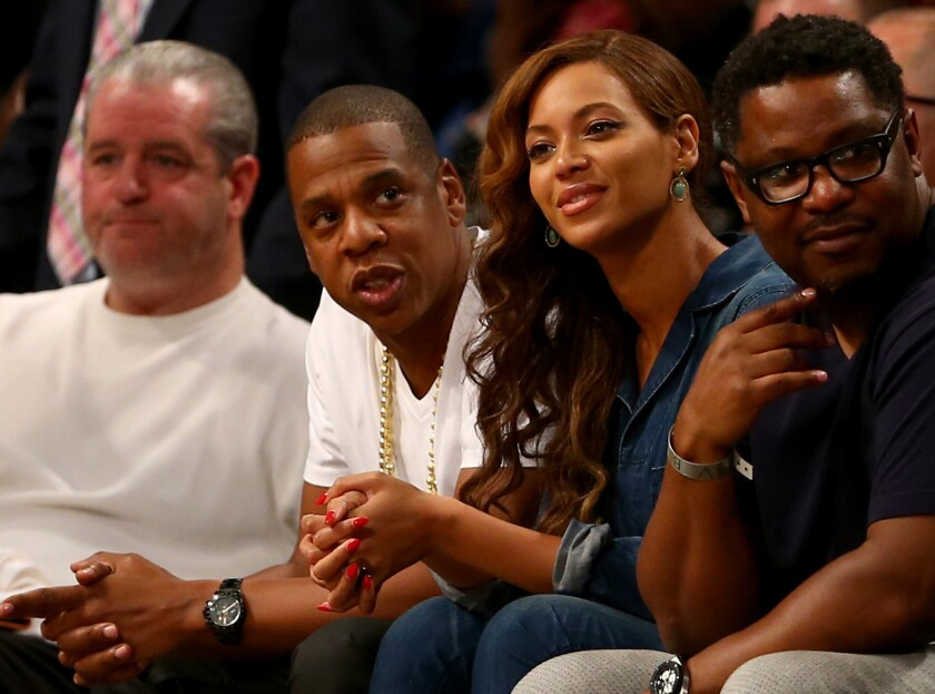 Jay Z, second from left, and Beyonce attend a semifinals game between the Brooklyn Nets and Miami Heat in New York City on Monday, the same day that video footage of an elevator fight involving them and Solange Knowles leaked online.