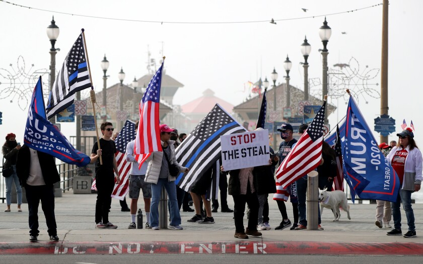 President Donald Trump supporters rally in Huntington Beach on Wednesday.
