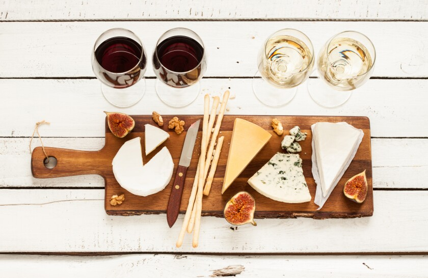 Red and white wine plus different kinds of cheeses