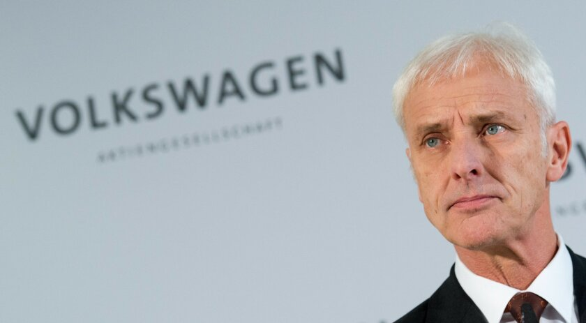 Matthias Mueller, Volkswagen AG CEO, speaks during a news conference in Wolfsburg, Germany, Friday Nov. 20, 2015. Volkswagen CEO Michael Mueller says the company's board has decided to reduce capital expenditures by 1 billion euros (US $1.07 billion) in 2016 as it deals with the fallout of its emissions-rigging scandal. Mueller said Friday after a meeting of the board at company headquarters in Wolfsburg, German, that the cuts would bring capital expenditure down to 12 billion euros next year. (Julian Stratenschulte/dpa via AP)