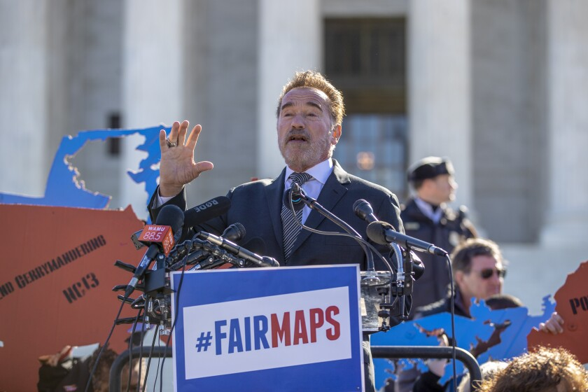 """FILE - In this March 26, 2019, file photo former California Gov. Arnold Schwarzenegger speaks at a rally calling for """"Fair Maps"""" at the Supreme Court in Washington. In California its last Republican governor, Arnold Schwarzenegger, passed a 2008 ballot measure creating a nonpartisan commission. (AP Photo/Carolyn Kaster, File)"""