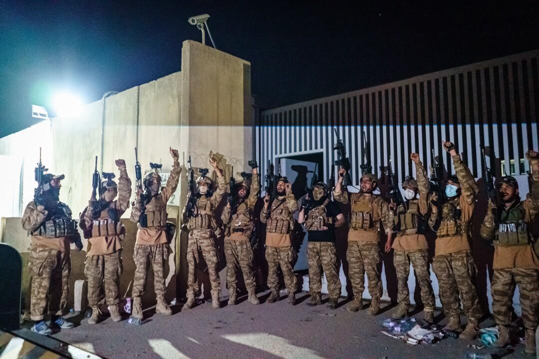Taliban fighters from the Fateh Zwak unit celebrate.